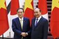 菅首相とフック首相が会談、12件の協力文書に署名
